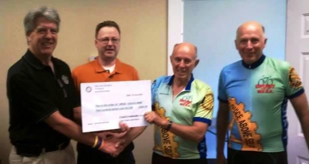 Bob Scott, Pesident, and Frank Krepasky, Treasurer present big check to Allen Porter, MESA rider for the club. and Bill Pepple Tour Leader